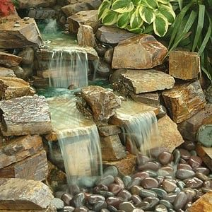 Pondless Waterfalls - Pondless waterfalls are far less maintenance than the standard pond waterfalls. The idea of a pondless waterfall is to have the beauty of the waterfall both in site and sounds but the water then disappears only to be recycled and returned to the top of the waterfall.