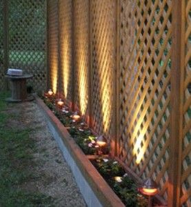 @Casey Moyer!!! GREAT idea for a privacy fence that's easier on the pocketbook. Lattice to the height you want and the solar lights gives it the finished look.