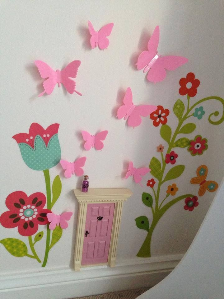 Love the use of 3d butterflies on the wall above the fairy door.