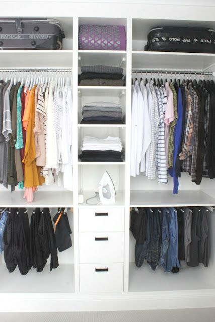 walk-in closet (blog is in swedish)  I like the idea of having a shelf above the bottom rack.  No more poking holes in my shirts from the pant hangers.