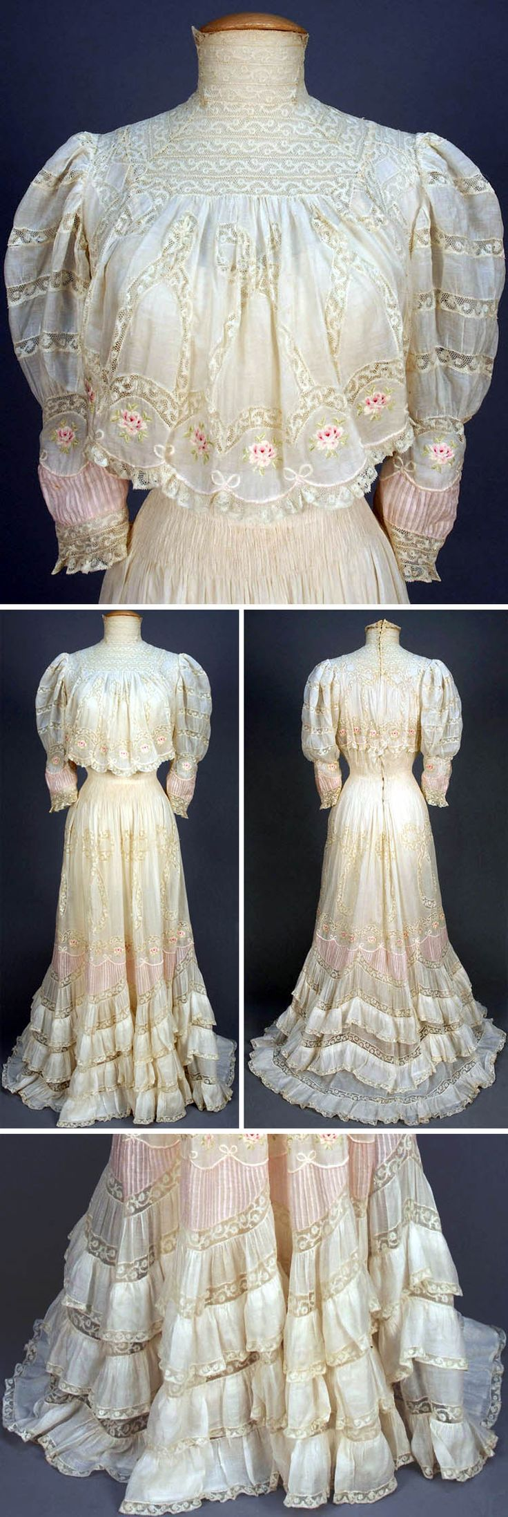Circa 1900 Tea Gown: White cotton lawn with high neck of Valenciennes lace and bands in pattern of loops and bows. Another band of polychrome embroidered roses at lower bodice, sleeves, and skirt, which also have scalloped inserts of tucked pink cotton beneath embroidered bows. Lower skirt ruffled in three bands. Via Whitaker Auctions.