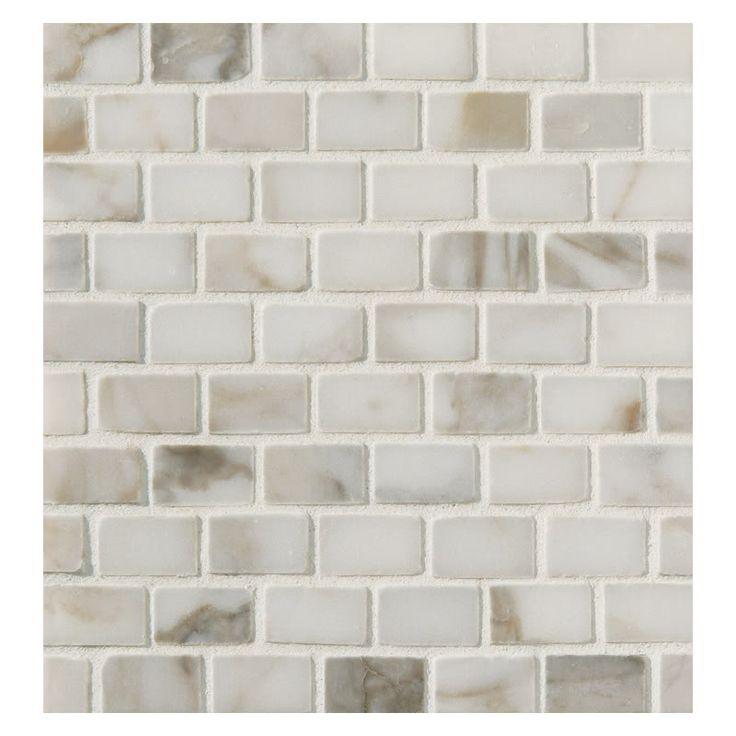 Mini Calcutta gold marble tile backsplash - Love this