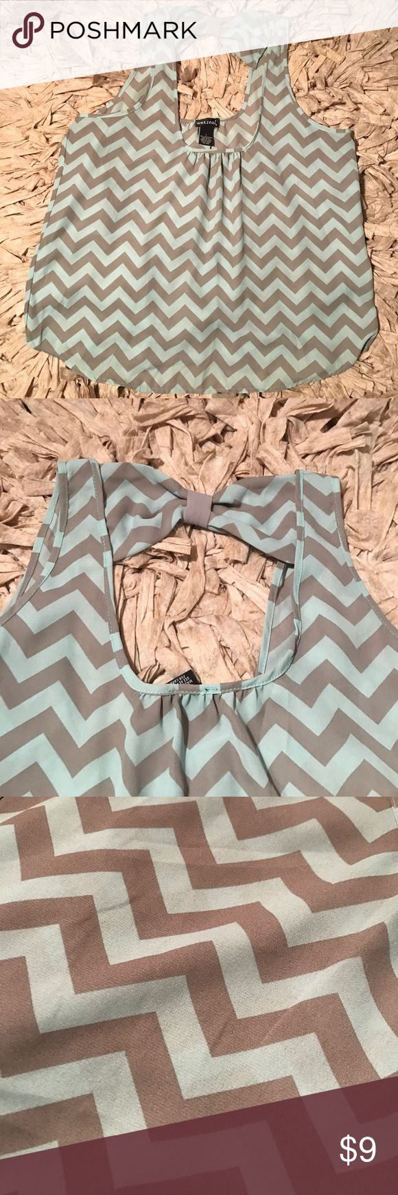 Chevron blouse with bow back detail Large Grey and teal chevron blouse with a bow back detail. Size Large. Wet Seal Tops Blouses