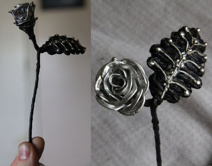 Soda Tab Rose; constructed from roughly 15 tabs, solder and a spray-painted wire for the stem & leaf.