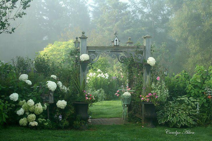 Fairy's waiting behind the gate....  see the hostas and companion plants