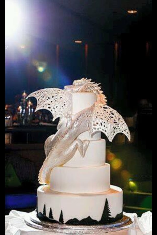 Amazing white, silver dragon cake! I can see this being a wedding cake due to the color. Nerd wedding!!! <3