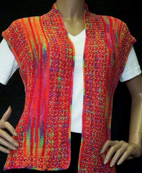 Parrot Beaded Vest This vest is knit side to side in Rayon Metallic and Sock Plus in Parrot and Red Coral. The side and neck bands are beaded and adds texture and drape to the vest.