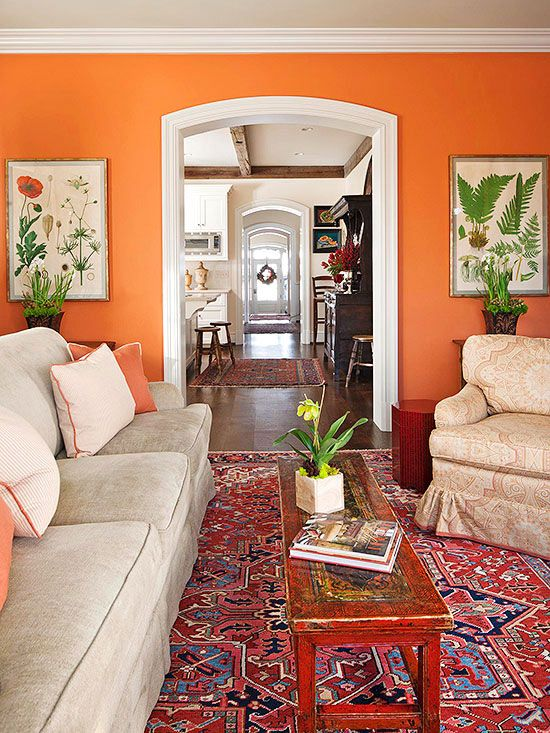 Even traditionally minded decor can benefit from a jolt of unexpected wall color. Here, a bright spice orange infuses a classic living room with energy. The color is used in small doses throughout the room so the wall color doesn't appear as an afterthought. The Color: Bryce Canyon -- Benjamin Moore