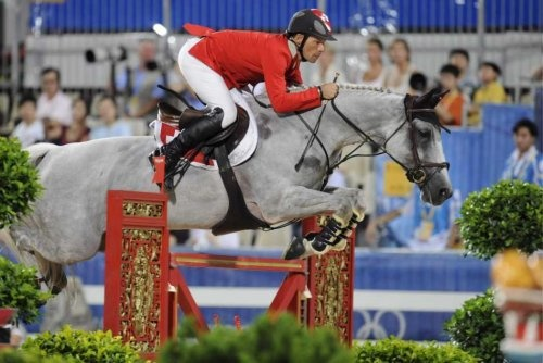 Swiss show jumper Pius Schwizer and his horse Nobless compete in the 2nd qualifier of the jumping team event at the Equestrian Venue of the Beijing Olympic Games 2008 in Hong Kong, China 17 August 2008.  EPA/JOCHEN LUEBKE