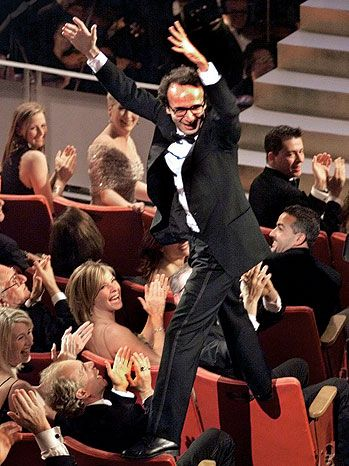 Roberto Benigni after winning an Oscar for best foreign film i will always remember this day i was cryimg infront of my tv !! Hes the best !! Theres no actor in this world like him that he can make you feel in love bcuz the love for hes wife is to strong