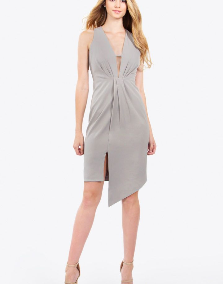 – Deep plunging asymmetrical midi dress – Sleeveless – Invisible zipper closure on back – Front strap detail on top – Color: Grey  Size + Fit – Model is wearing size S – Measurements taken from size S – Length: 45.75″ – Chest: 31.5″ – Waist: 27″