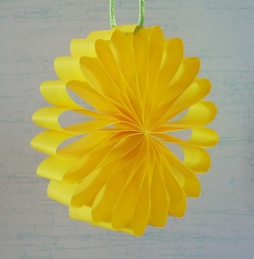 paper strips make paper flower  i want to hang these from