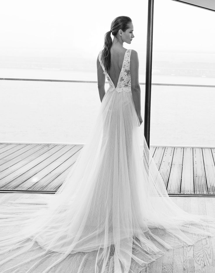 BOLIVIA // A plunging V-neck line flows out in a dreamy tulle skirt and is the perfect choice for your bohemian style wedding dress!