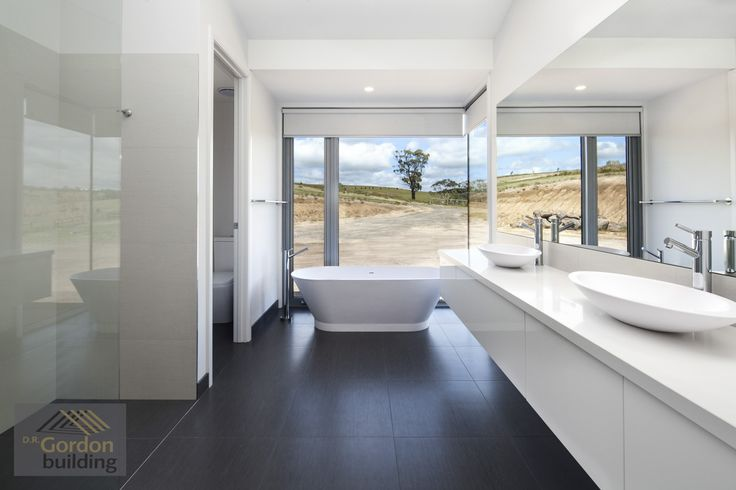 Country home - Large open windows, stand alone bath, double sink, fixed glass panel shower screen