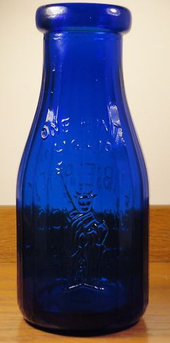 """Cobalt glass, one pint, """"Liberty"""" milk bottle. This bottle was made in Buffalo, N.Y."""
