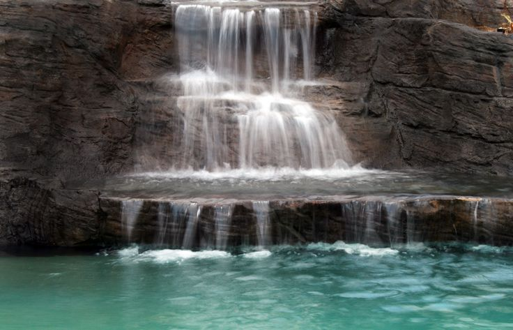 1000 images about swimming pool waterfalls on pinterest for Swimming pool waterfalls construction