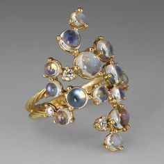 """Bring out your playful side with this Paul Morelli """"Bubble Cluster"""" ring. Moonstones and diamonds dance together with an 18K yellow gold band as the hostess. From all the way across the room, this gorgeous ring makes a sophisticated statement of bubbling joy...it's wonderfully contagious!<br><br>White diamonds = 0.14cttw<br>Ring measures 1"""" long<br>Size 6.25"""
