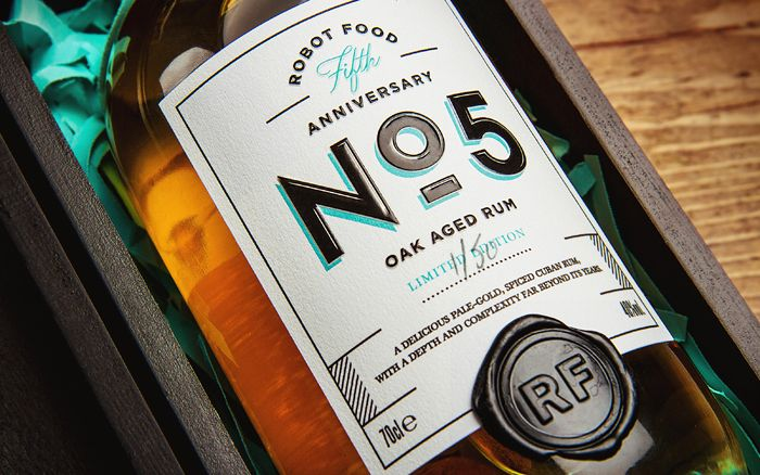 An appealing commemorative rum bottle designed by Robot Food for their fifth anniversary. ...But ...WHY ISN'T ANYONE MENTIONING CHANEL.