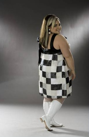 Nikki Blonsky - Tracy Turnblad   Personally, I think this most recent Tracy outfit is her best one for pin up bomb riding :-)