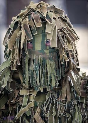 Яussian sniper in suit ...