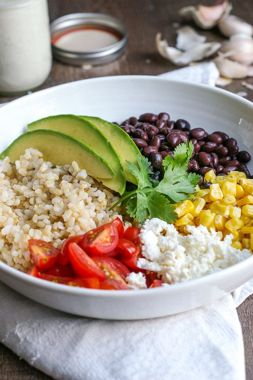 This Black Bean Rice Bowl with Garlic Yogurt Sauce is a copycat version of a dish at one of my favourite cafes! Vegetarian and Gluten Free.