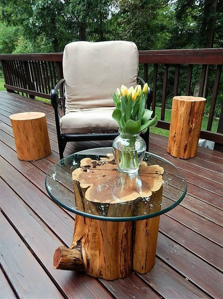 The easiest use of wooden tree log is to turn it simply into an exotic coffee table. This beautiful tree log is adorned with a glass top to make an intricate and fine coffee table. The natural grain of the log is kept intact and just a bit of finishing has been done on the bark.