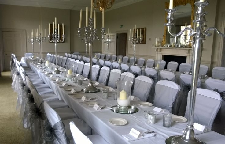 Silver organza sashes on white chair covers at Rudding Park