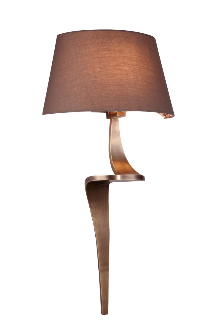 The Enzo pair of AB wall lamps by RV Astley boasts a frame finish in bronze/brass, with a brown light shade. Part of the Enzo range, this beautiful wall light is the perfect compliment to a minimalist living room.