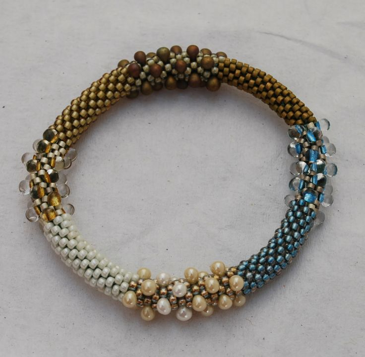 A beautiful ombre beaded bangle that would coordinate with most earth-tone fall ensembles.