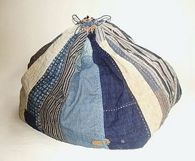 """Komebukuro (rice bag) were pieced of fragments of precious cotton cloth, and used when rice was given as a gift or an offering. This one (late 19th to early 20th century) has checked, striped and katazome (stencil-dyed) fabrics. A wooden tag has the owner's name.  It's unusually large, about 20"""" on a side. More photos at click"""