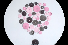 Round handcrafted pictures with sewed figures.