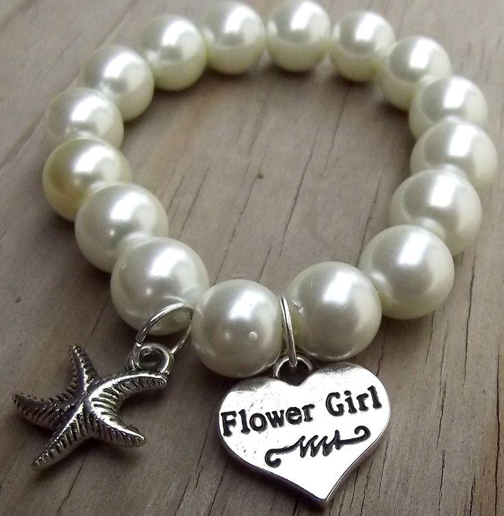 For Emma, Caspia and Calla Destination Beach Wedding: Star Fish Flower Girl Charm Bracelet. $9.50, via Etsy.