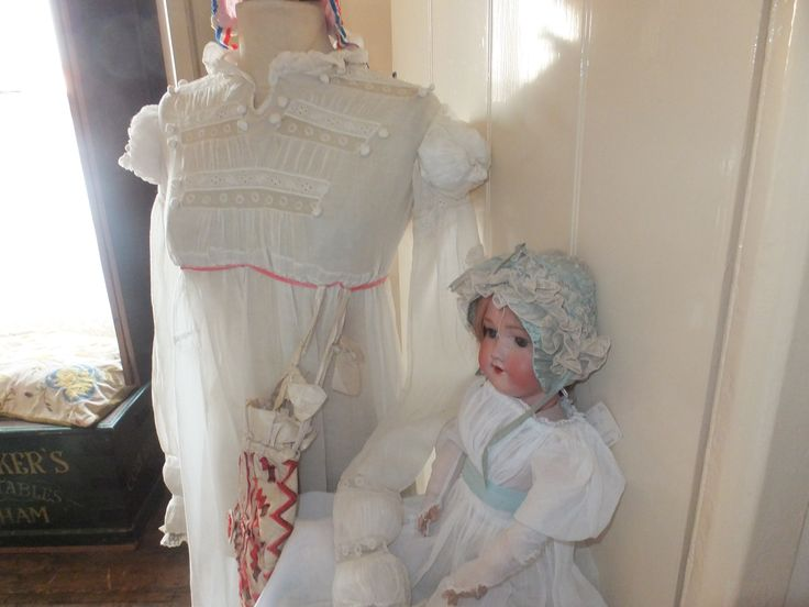 Early Regency infant bonnet in two parts: An under-bonnet in silk, and an over-bonnet with lots of fuss! Love that blue!