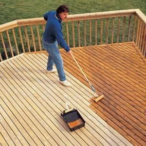 To stain your deck, you can use a paint roller to speed up the process and then go over everything with a paint brush to get to hard to reach areas. Alternatively, paint sprayers (or spray guns) work even better but they aren't absolutely necessity if you want to keep your budget low. If you plan on doing other home improvement projects, it might be an investment worth considering 1!