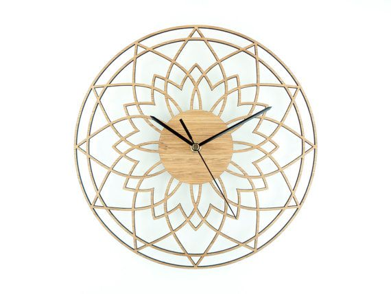 This bamboo wall clock is called Complex Star. The delicate design of this clock makes it a unique timepiece that looks great in a modern or traditional home and its natural colour fits well with any colour scheme.  The clock face is laser cut from eco friendly solid bamboo. Outside diameter of face is 280 mm (11).  The clock mechanism is a quartz sweep type which means its virtually silent, no ticking, and has black hands. Comes complete with integral fixing bracket so it`s ready to hang…