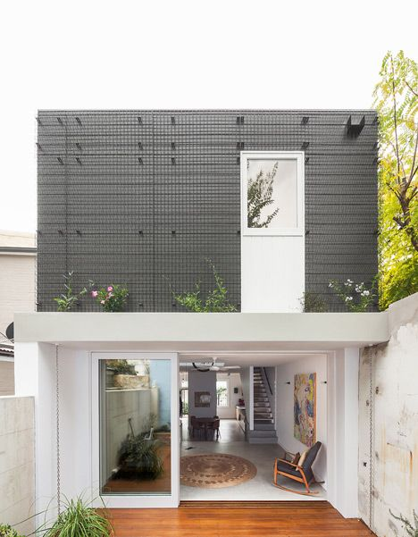 A pulley system extending through the atrium of this house in Sydney, Australia, is designed so the owners can store bicycles and winch them out of view