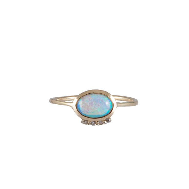 OPAL EYE gold and diamonds engagement ring by Michelle Oh