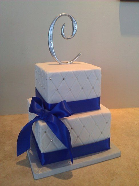 WE WOULD LIKE A TWO TIERED CAKE LIKE THIS IN THE CENTER OF A CUPCAKE DISPLAY.  I LOVE THE HATCHING WITH SILVER BLING.  WE WOULD DO SAPPIRE BLUE RIBBON(WITHOUT BOW) Royal blue & white wedding cake by http://ccsweetsensations.com