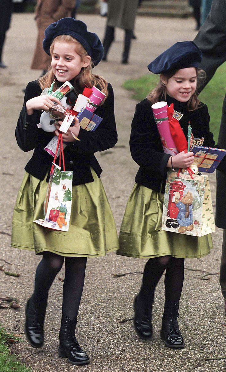 A young Princess Beatrice and her sister, Eugenie, carried handfuls of presents while heading to church on ...
