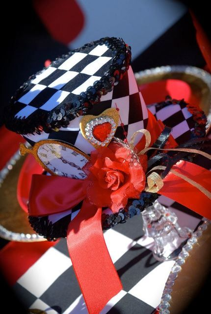 Decorated hat at a Alice in Wonderland Valentine's Day Party #aliceinwonderland #valentine  www.tablescapesbydesign.com https://www.facebook.com/pages/Tablescapes-By-Design/129811416695 #DisneySide