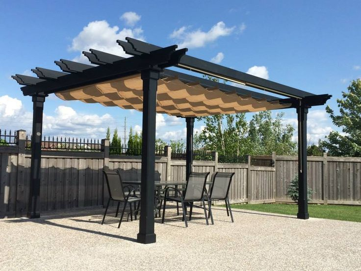Stained black colonial pergola with top Nesling Harmonica Shade for added sun protection