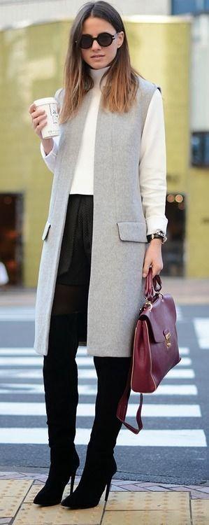 Work: grey long sleeveless vest, black pants, white button down, hair down