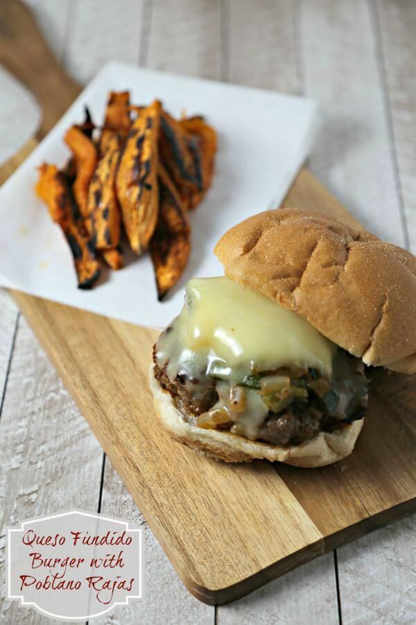 This Queso Fundido Burger with Poblano Rajas is an epic burger with fresh chorizo, ground chuck & melted cheese accented by smoky poblanos. Hungry yet? | Cooking In Stilettos