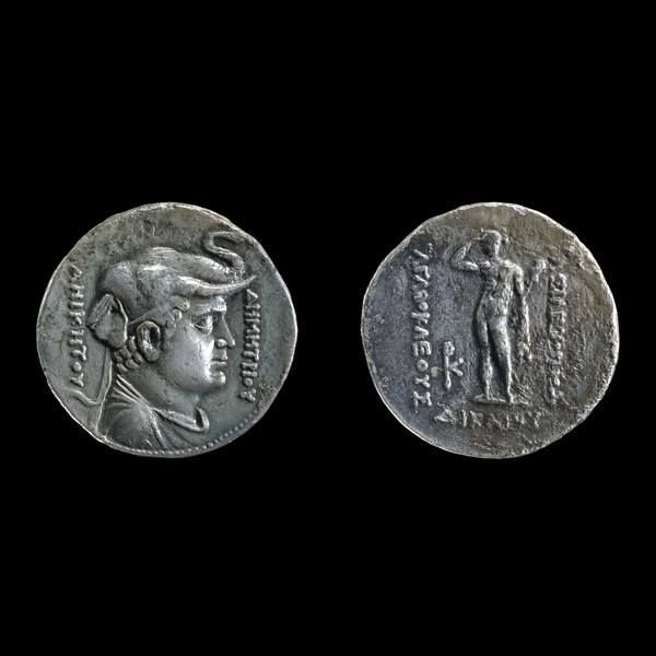 Silver tetradrachm of Agathocles, Greek Bactrian, about 190-180 BCE. This coin carries the portrait of Demetrius I (reigned around 200-190 BCE), wearing the elephant-scalp head-dress of Alexander the Great. The elephant-scalp is a reference to the conquest of territories in India accomplished by both these kings. Herakles appears on the reverse, holding a club and lionskin, with the Greek legend 'of king Agathocles the Just' ranged on three sides.