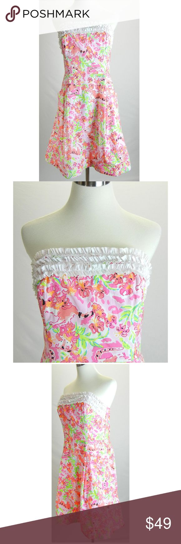 """LILLY PULITZER Dress Empire Flamingo Strapless dress from Lilly Pulitzer  Pink, white, green Flamingo print Ruffles across the chest Boning & fitted bodice Strapless Empire waist, a-line Pleated skirt 2 front pockets Lined Hidden back zipper Above the knee 100% cotton Hand wash, line dry Tagged size:  10 Excellent condition, no flaws  Please check measurements to determine fit All measurements are given in full Chest  34"""" Waist  32""""  Hips  42""""  Length  29.5"""" Lilly Pulitzer Dresses Strapless"""