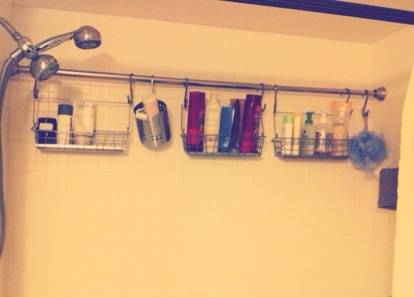 Add an extra shower curtain rod to the shower and hang caddies from it to save space
