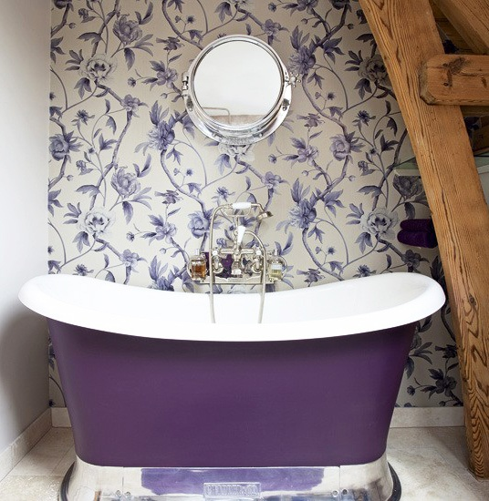 purple bathtub and floral wallpaper