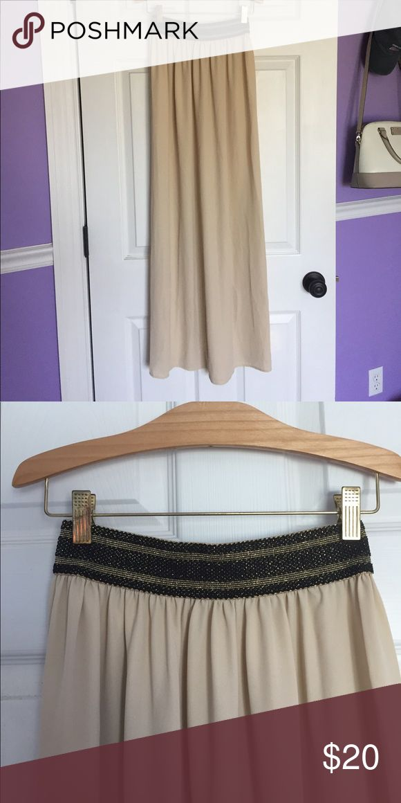 Francesca's beige maxi skirt with glitter waiste This maxi skirt from francesca's is simple yet stunning, and the sparkly waist band is a great detail! Would make a great piece for a night out outfit or even for a beach event! Francesca's Collections Skirts Maxi