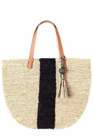 Pipeline Tote by KAYU. Straw tote featuring leather handles, center stripe and removable tassel. Handcrafted by local artisans in the Philippines.