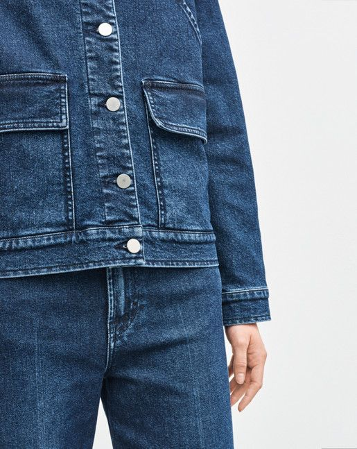 Filippa K inspiration - The look of now: Workwear blues. Cut in a cool, loose silhouette, our workwear-inspired denim jacket is made of super comfortable stretch denim. Contrasting coloured buttons in a faded silvery hue. Elbow patches in the same denim material and six front pockets.